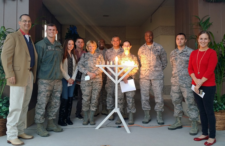 The Laughlin Chapel team and members of Laughlin pose for a photo after lighting the Menorah on Laughlin Air Force Base, Texas, Dec. 7, 2015. The Menorah is a candelabrum lit during the eight-day holiday of Hanukkah. (Courtesy photo)