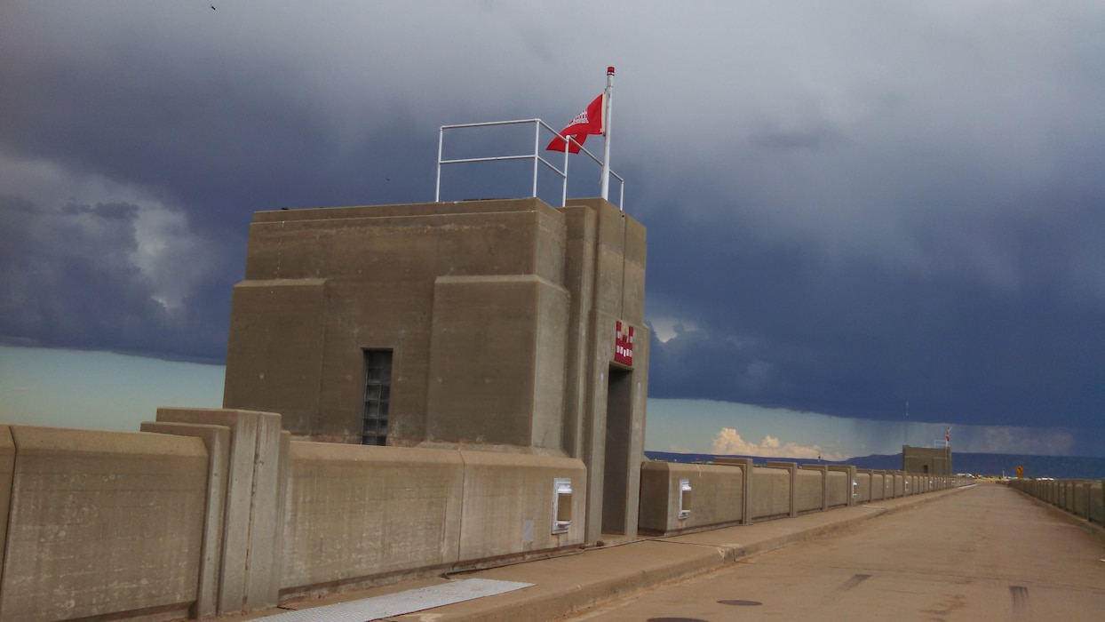 CONCHAS DAM, N.M. – The North pier house on the dam with stormy skies above, June 1, 2015. Photo by Valerie Mavis.
