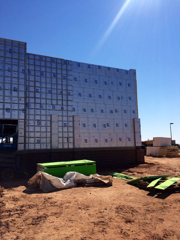 CANNON AIR FORCE BASE, N.M. – The installation of polyisocyanurate insulation on a building on base, Sept. 28, 2015. Photo by James Vigil. This was a 2015 photo drive entry.
