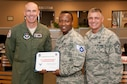 """Airman 1st Class Christophore Hountohotegbe, a 71st Force Support Squadron force management journeyman, accepts his senior airman below the zone stripes from Col. Clark Quinn, the 71st Flying Training Wing commander, and Chief Master Sgt. Peter Speen, the 71st FTW command chief, Dec. 7. BTZ allows commanders to promote a select number of outstanding airmen 1st class to senior airmen six months early. Airman """"H"""" as his peers call him is set to sew on E-4 Feb. 8, 2016. (U.S. Air Force photo by Tech. Sgt. James Bolinger)"""