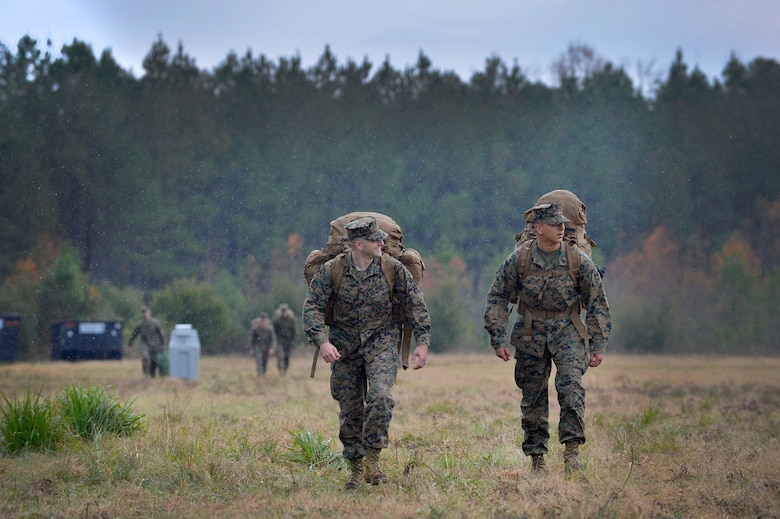 Two U.S. Marines assigned to the 273rd Marine Wing Support Squadron walk through the rain to & Marines prepare for week-long exercise u003e Shaw Air Force Base ...