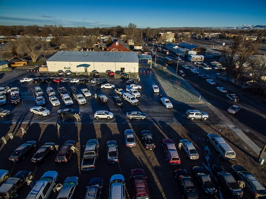 Law enforcement vehicles line up to convoy through Mountain Home, Idaho, Dec. 5, 2015. Military and civilian law enforcement officers each took children to the nearby shopping center to purchase presents for their families during the annual Shop with a Cop event.(Courtesy photo by Samuel Morse)