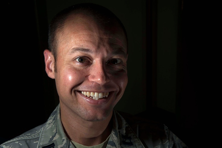 """Capt. James Scott, Holm Center Curriculum Directorate Field Leadership chief, poses for a portrait Dec. 3, 2015 at Maxwell Air Force Base, Ala. Scott is scheduled to debut in his first performance as Keith Hartley in the Christmas comedy """"Merry Christmas, Dear Grandpa."""" (U.S. Air Force photo by Airman 1st Class Alexa Culbert)"""