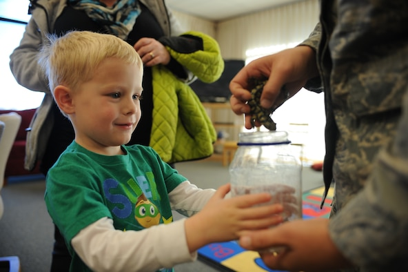 Nolan Trautner gets a closer look at a salamander while attending Little Warriors Story Time at the Holbrook Library at Ellsworth Air Force Base, S.D., Nov. 19, 2015. The library holds three programs that aim to equip children with knowledge and promote literacy and socialization. For more information about these and other library programs, call (605) 385-1688. (U.S. Air Force photo by Airman Sadie Colbert/Released)