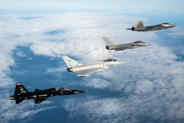 A U.S. Air Force T-38 Talon, British Royal Air Force Typhoon, French air force Rafale and U.S. Air Force F-22 Raptor fly in formation as part of a Trilateral Exercise held at Langley Air Force Base, Va., Dec. 7, 2015. The 1st Fighter Wing hosted the exercise which focuses on operations in a highly-contested operational environment. (U.S. Air Force photo by Senior Airman Kayla Newman)