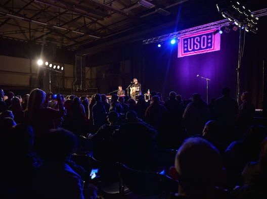 Singer Chris Daughtry performs a song during the 2015 USO Holiday Troop Tour Dec. 9, 2015, at Ramstein Air Base, Germany. Daughtry was accompanied by the Chairman of the Joint Chiefs of Staff, U.S. Marine Corps Gen. Joseph F. Dunford Jr., and other singers, songwriters, actresses and Major League Baseball players. (U.S. Air Force photo/Staff Sgt. Leslie Keopka)