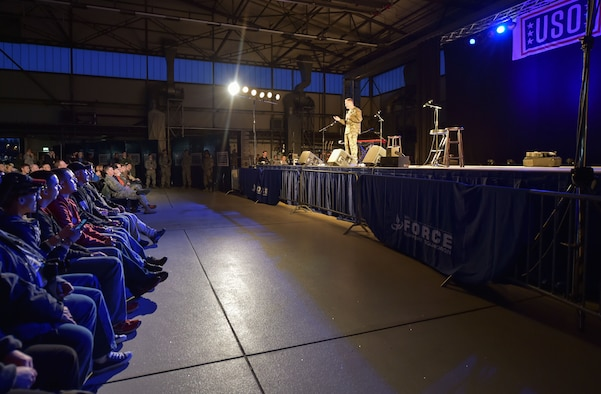 U.S. Marine Corps Gen. Joseph F. Dunford Jr., chairman of the Joint Chiefs of Staff, introduces the celebrities from the 2015 USO Holiday Troop Tour, Dec. 9, 2015, at Ramstein Air Base, Germany. Dunford accompanied the special guest during the USO's annual troop tour that includes several stops to visit service members overseas. (U.S. Air Force photo/Staff Sgt. Leslie Keopka)