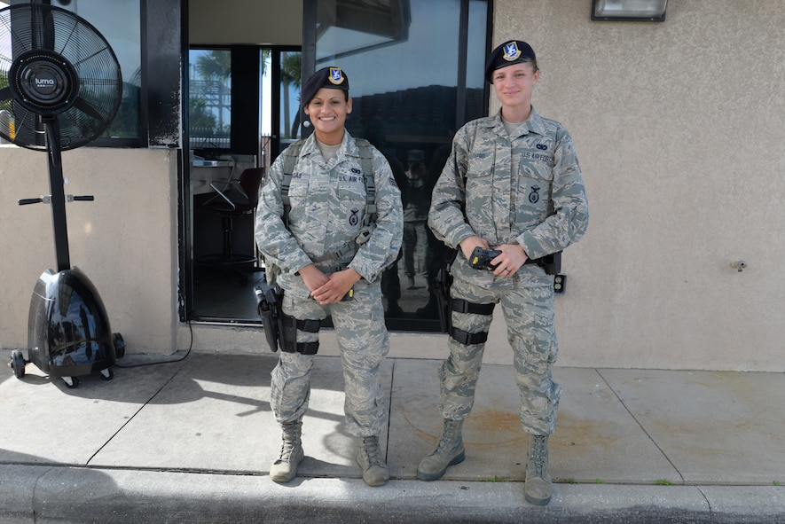 Senior Airman Carmen Bigas, and Airman 1st Class Samantha Lero, both 45th Security Forces Squadron defenders, saved the day by identifying and responding to a drunk driver during their shift, Dec. 8, 2015, at the Patrick Air Force Base gate, Fla. The duo protected the lives of innocent motorists and the 45th Space Wing Team when a driver, who was later tested and identified with the breath alcohol content of 0.159, attempted to enter the base. December has been designated National Drunk and Drugged Driving Prevention Month, a time to raise awareness about the consequences of driving under the influence of alcohol and drugs. (U.S. Air Force photo/1st Lt. Alicia Premo) (Released)