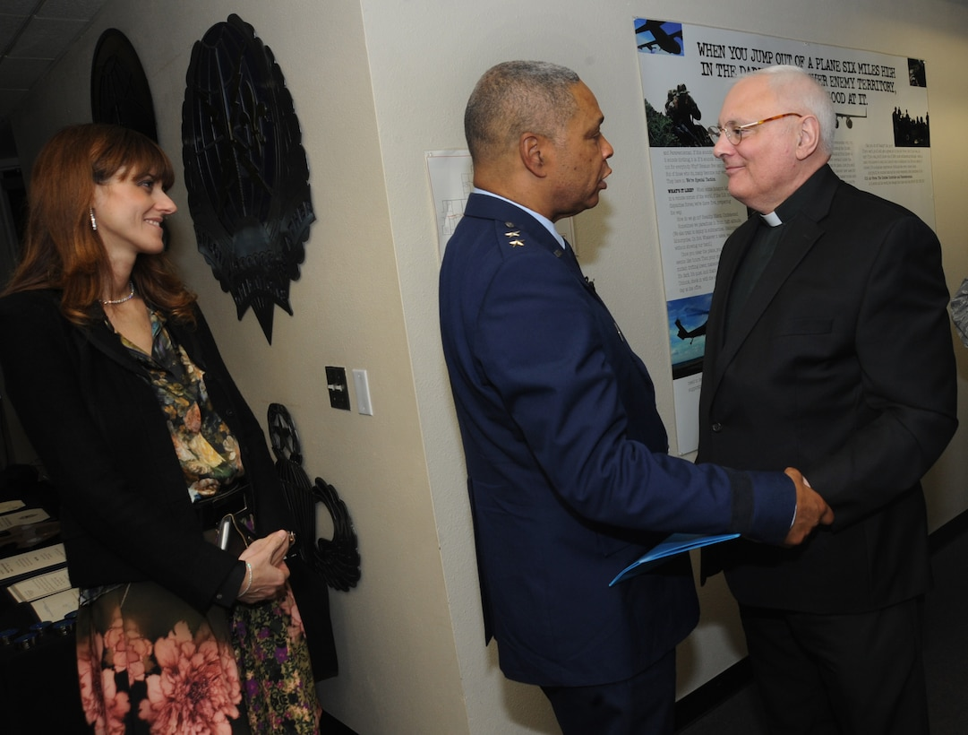 U.S. Air Force Maj. Gen. Garry Dean, The Special Assistant to the Chief, National Guard Bureau, along with his wife Elena, greet retired Oregon Air National Guard Chaplain Richard Sirianni, who delivered the Invocation during General Dean's formal retirement ceremony, Dec. 6, 2015, Portland Air National Guard Base, Ore. (U.S. Air National Guard photo by Tech. Sgt. John Hughel, 142nd Fighter Wing Public Affairs)