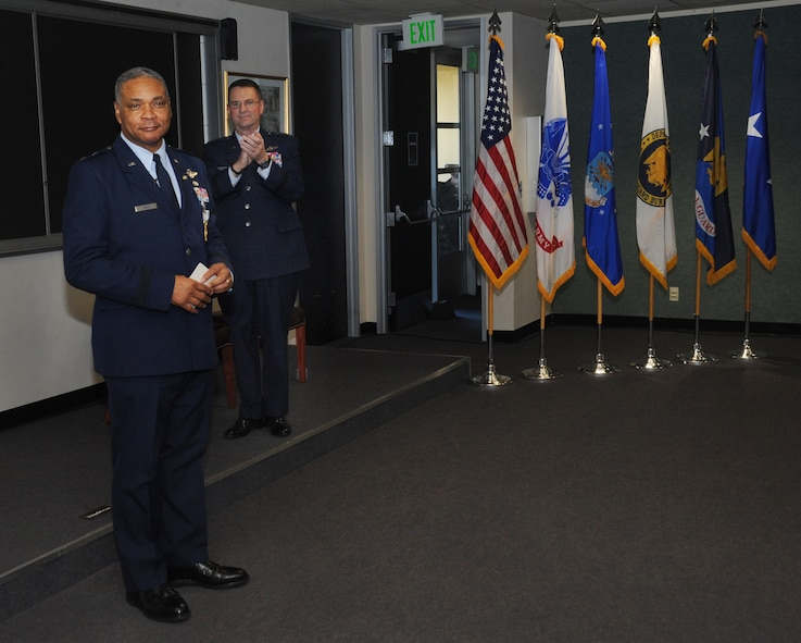 U.S. Air Force Maj. Gen. Garry Dean, The Special Assistant to the Chief, National Guard Bureau, left, address his closing remarks to those in attendance during his formal retirement ceremony held at the Portland Air National Guard Base, Ore., Dec. 6, 2015. (U.S. Air National Guard photo by Tech. Sgt. John Hughel, 142nd Fighter Wing Public Affairs)