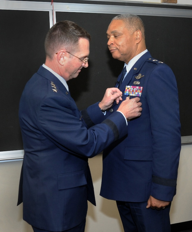 U.S. Air Force Lt. Gen. Joseph L. Lengyel, Vice Chief, National Guard Bureau, left, presents The Distinguished Service Medal to Maj. Gen. Garry Dean, The Special Assistant to the Chief, National Guard Bureau, right, during his formal retirement ceremony held at the Portland Air National Guard Base, Ore., Dec. 6, 2015. (U.S. Air National Guard photo by Tech. Sgt. John Hughel, 142nd Fighter Wing Public Affairs)