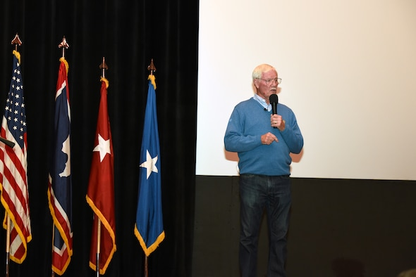 Retired U. S. Air Force Col. Ed Hubbard speaks to 153rd Airlift Wing members, Dec. 5, 2015 at F.E. Warren AFB in Cheyenne, Wyoming. Hubbard detailed his experiences as a POW and provided insight on keeping a positive attitude during captivity. (U.S. Air National Guard photo by Tech. Sgt. John Galvin/released)