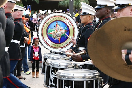 The Marine Corps Band New Orleans marches down the streets of New Orleans during the Bayou Classic Thanksgiving Parade in New Orleans on November 26, 2015. The Bayou Classic is the annual series of fan events and leading up to the rivalry football game between Southern University and Grambling State University held the week of Thanksgiving. (U.S. Marine Corps photo by Sgt. Rubin J. Tan/Released)