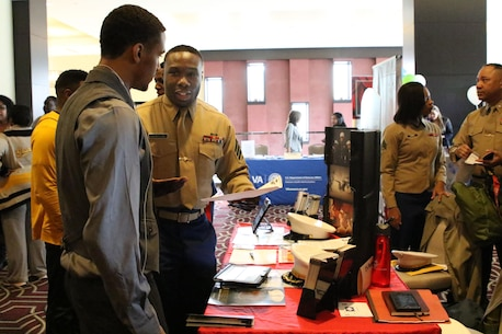 Sergeant Devon McIntyre, Marine Corps Recruiting Station Baton Rouge officer selection assistant, speaks to a prospect during the Bayou Classic career fair at the Hyatt Regency Hotel New Orleans, Nov. 27, 2015. The Marine Corps has been partners with the Bayou Classic for the past 15 years as a way to connect and strengthen the United States Marine Corps' relationship with Historically Black College Universities while also reinforcing the idea of the armed services as a viable career option for college and high school graduates. (U.S. Marine Corps photo by Sgt. Rubin J. Tan/Released)