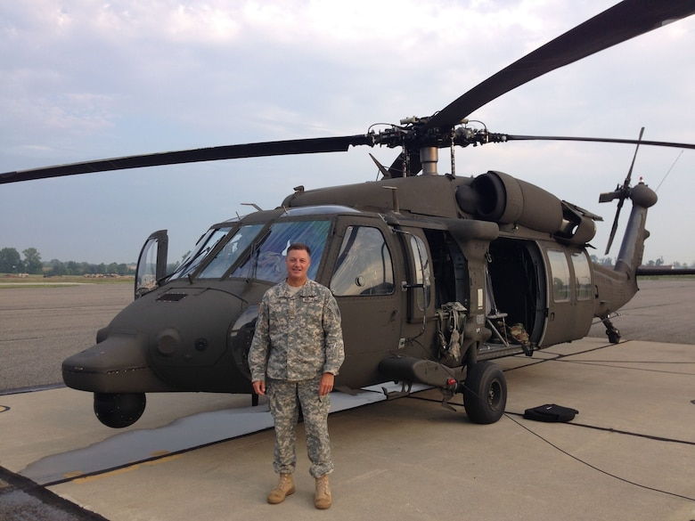 U.S. Army Reserve aviator Lt. Col. Gatlen Sisk poses in front of a UH-60 Black Hawk helicopter. Sisk is an aviation liaison officer (LNO) assigned to the 11th Theater Aviation Command (TAC) out of Fort Knox, Ky. The 11th TAC is the only aviation command in the U.S. Army Reserve. The 11th TAC has two missions, functioning as both a warfighting headquarters and as a functional command. As warfighting command, the 11th TAC provides command and control, staff planning, and supervision for two aviation brigades and one air traffic service battalion. As a functional command, the 11th TAC provides command and control for all U.S. Army Reserve aviation. (Courtesy photo)