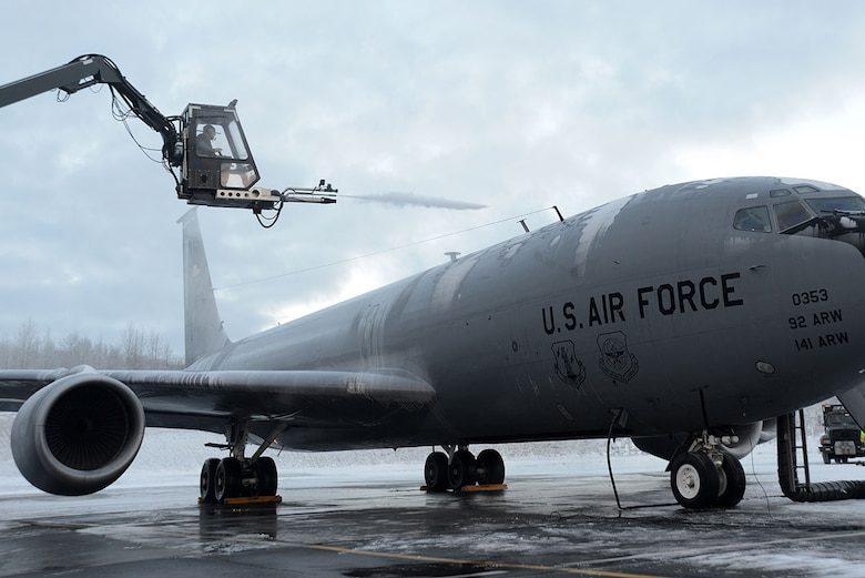 Staff Sgt. Tyler Derr, a 732nd Air Mobility Squadron avionics specialist, deices a KC-135 Stratotanker from Fairchild Air Force Base, Wash., on the flightline at Joint Base Elmendorf-Richardson, Alaska, Dec. 3, 2015. There is always a person in the truck, one in the deicer and one on the ground to make sure the aircraft is deiced all around. (U.S. Air Force photo/Airman 1st Class Christopher R. Morales)