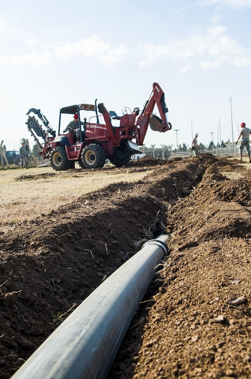 Airmen from the 39th Communications Squadron install underground communications lines, the framework for communication infrastructure Nov. 18, 2015, at Incirlik Air Base, Turkey. The underground communication cable is the first of many steps to establishing a communications infrastructure. The squadron works to establish and maintain new and old infrastructure to ensure Incirlik and Operation Inherent Resolve missions are accomplished. (U.S. Air Force photo/Staff Sgt. Jack Sanders)