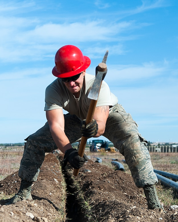 Airman 1st Class Trevor Hermosillo, a 39th Communications Squadron cable and antenna technician, unearths rocks while preparing to install underground communication lines Nov. 18, 2015, at Incirlik Air Base, Turkey. Laying communication cable is the first of many steps to establishing communications infrastructure. The squadron works to establish and maintain new and old infrastructure to ensure Incirlik and Operation Inherent Resolve missions are accomplished. (U.S. Air Force photo/Staff Sgt. Jack Sanders)