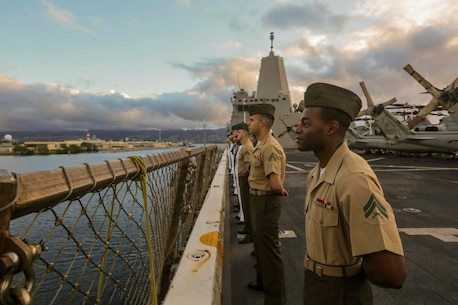 PEARL HARBOR, Hawaii (Dec. 6, 2015) U.S. Marines and Sailors man the rails as the USS Anchorage (LPD 23) pulls into port in Hawaii.  Hawaii is the 15th Marine Expeditionary Unit's last port call before heading home after their WESTPAC 15 deployment. (U.S. Marine Corps photo by Sgt. Jamean Berry/Released)