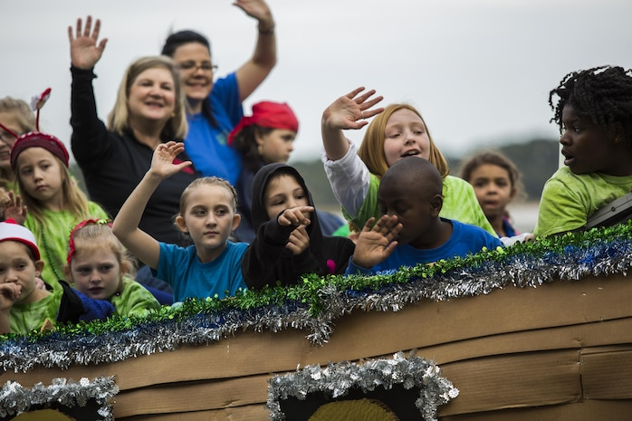 Children wave from a Noah's Ark themed float during the Beaufort Christmas Parade Dec. 6. The Christmas parade is one of the many celebrations and events that have occurred throughout the area to celebrate the holidays including a Christmas tree lighting ceremony for residents of Laurel Bay housing community Dec. 3.