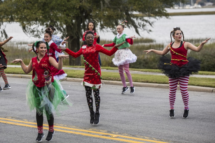 Dancers perform during the Beaufort Christmas Parade Dec. 6. Viewers of the procession lined the streets as the parade headed down town. Some wore holiday themed costumes to celebrate the season. Children passed out candy and Christmas cards as they walked down the street.