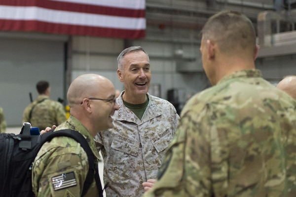 U.S. Marine Corps Gen. Joseph F. Dunford Jr., chairman of the Joint Chiefs of Staff, talks with U.S. service members after a USO show at Bagram Airfield, Afghanistan, Dec. 8, 2015. Dunford was traveling along with entertainers from the 2015 USO Holiday Tour to visit deployed service members. DoD photo by D. Myles Cullen