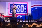 U.S. Marine Corps Gen. Joseph F. Dunford Jr., chairman of the Joint Chiefs of Staff, addresses the audience of deployed U.S. service members before a USO show in Camp Lemonnier, Djibouti, Dec. 6, 2015. The chairman, along with members of the 2015 USO Entertainment Troupe, are visiting service members and their families to express the country's gratitude for their service while deployed during the holidays in defense our nation. DoD photo by D. Myles Cullen