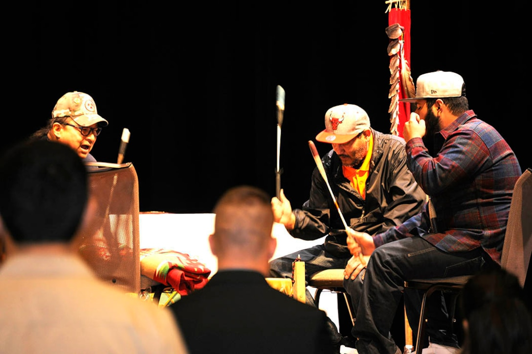 "Tribal veterans from the Nottawasippi Huron Band of Potawatomi perform a ""Welcome Song"" and a ""Veterans Song."" Photo by Jace Armstrong"