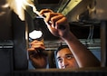 Airman 1st Class William Hamal, a 19th Maintenance Squadron aircraft structural maintenance journeyman, replaces a forward main landing gear strut on a C-130J Super Hercules Nov. 19, 2015, at Little Rock Air Force Base, Ark. Aircraft structural maintenance personnel restore and maintain the structural integrity of aircraft. (U.S. Air Force photo/Senior Airman Stephanie Serrano)