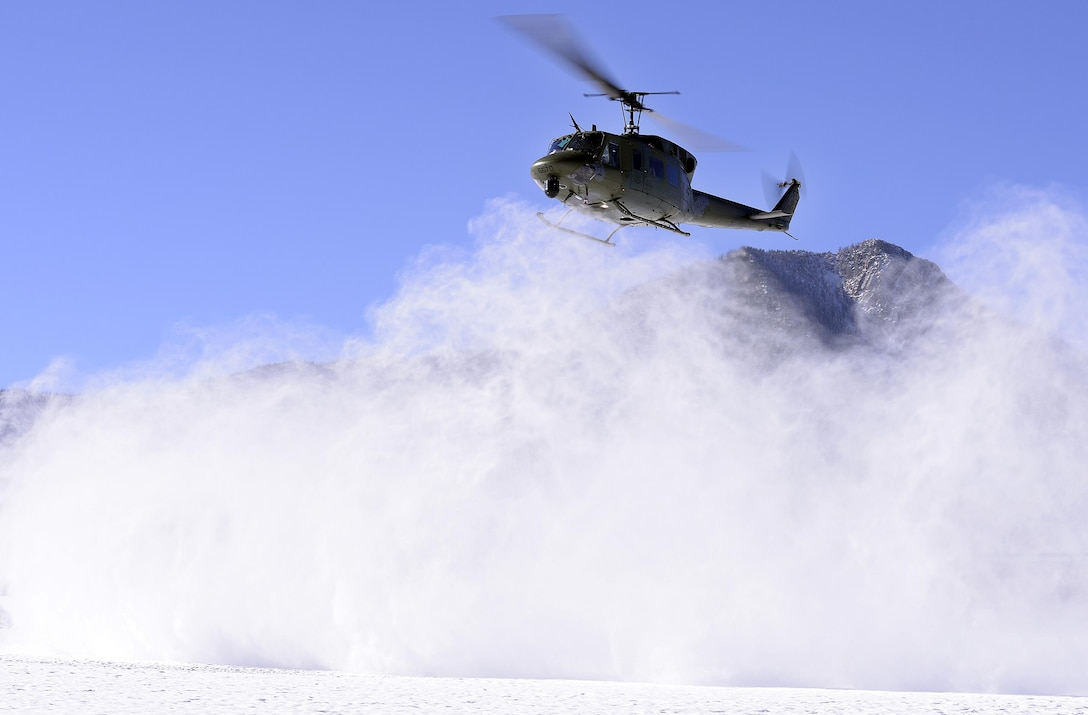 A UH-1N Huey from the 37th Helicopter Squadron at F.E. Warren Air Force Base, Wyo., lands at the U.S. Air Force Academy's preparatory school in Colorado Springs, Colo., Nov. 30, 2015. The helicopter and crew familiarized cadet candidates with the aircraft and its mission. (U.S. Air Force photo/Mike Kaplan)