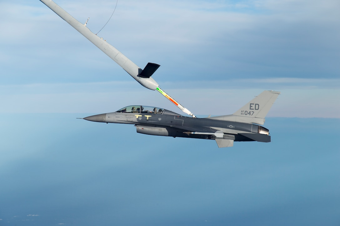 An F-16 Fighting Falcon from the 416th Flight Test Squadron at Edwards Air Force Base, Calif., is in the process of a midair fuel transfer from a Royal Australian Air Force KC-30A tanker Dec. 3, 2015. This was the first flight as part of a coalition tanker aerial refueling certification effort to qualify Australian, United Arab Emirates and Italian tankers to refuel U.S. Air Force F-16s, F-15 Eagles, B-1B Lancers, and A-10 Thunderbolt IIs using their respective booms. The test team will check for qualities such as fuel pressure surges, stability of the aircraft being refueled and the handling qualities of the boom for certification. (U.S. Air Force photo/Christian Turner)
