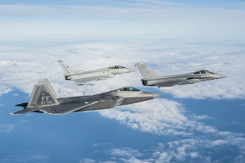 An F-22 Raptor, Royal Air Force Typhoon FGR4 and French air force Rafale fly in formation as part of a trilateral exercise held at Joint Base Langley-Eustis, Va., Dec. 7, 2015. The exercise simulates a highly contested, degraded and operationally limited environment where U.S. and partner pilots and ground crews can test their readiness. (U.S. Air Force photo/Senior Airman Kayla Newman)