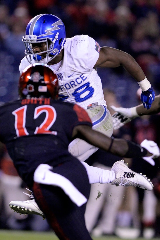 Jacobi Owens, a U.S. Air Force Academy Falcons running back, runs with the ball against San Diego State in San Diego, Dec. 4, 2015. Air Force lost to San Diego State 27-24. (U.S. Air Force photo/Mike Kaplan)