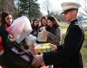 "Franklin Square, NY. – Capt. Francisco Pietri, the base operations officer for the 1st Marine Corps District, helps students from H. Frank Carey High School load toys into a truck, Dec. 10. The toys are donations from the seniors of H. Frank Carey High School to kids through the United States Marine Corps Reserve ""Toys for Tots"" program."