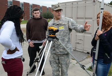 1st Lt. Bryan Underwood discusses surveying methods with students at Jacksonville High School during a recent Science, Technology, Enginering and Math (STEM) outreach visit. A U.S. Army combat engineer officer, Underwood has a bachelors degree in civil engineering. (USACE photo by Hank Heusinkveld)