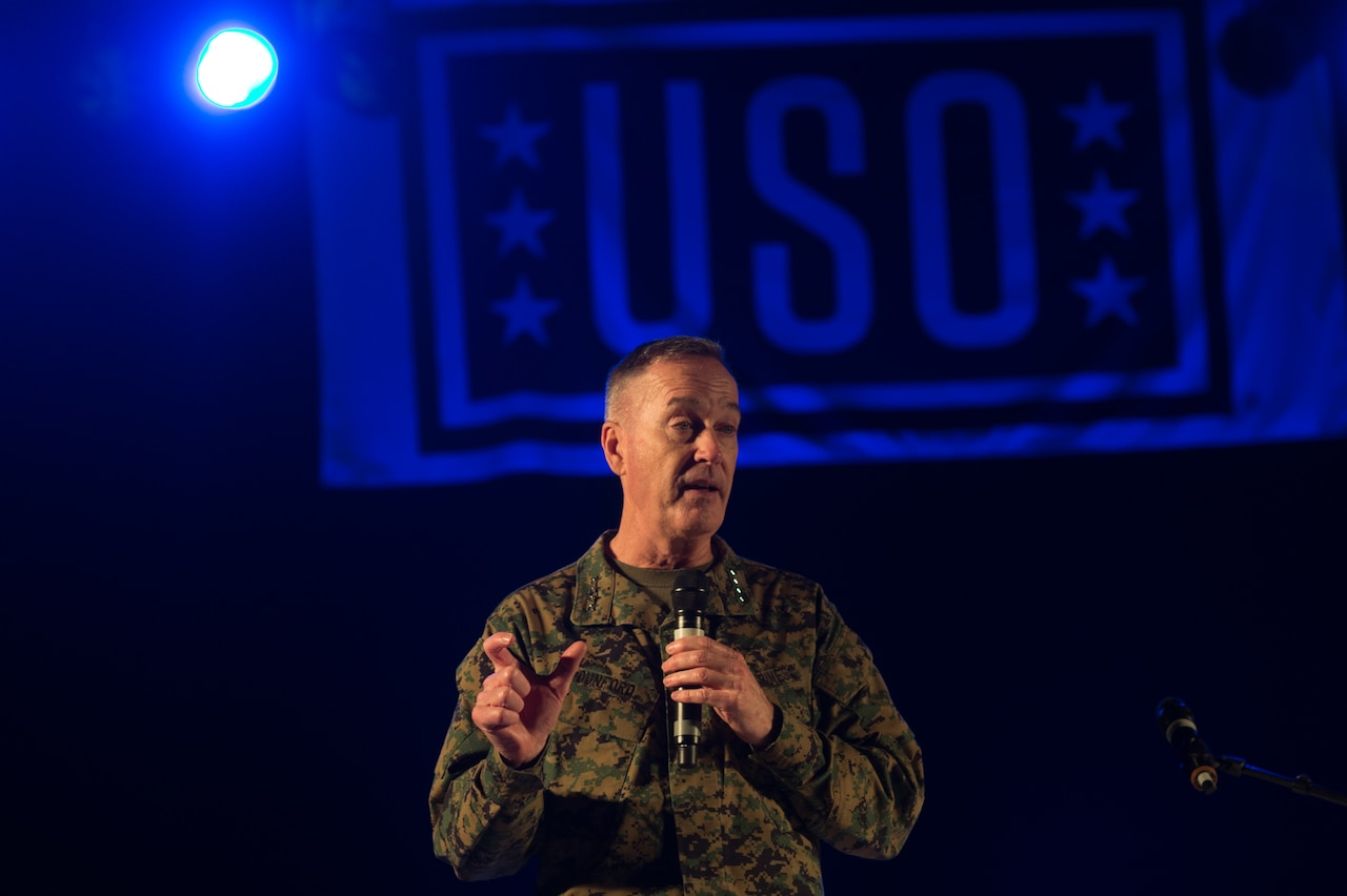 U.S. Marine Corps Gen. Joseph F. Dunford Jr., chairman of the Joint Chiefs of Staff, talks with service members and their families before the start of a USO show on Ramstein Air Base, Germany, Dec. 9, 2015. Dunford and entertainers with the 2015 USO Holiday Tour traveled to various locations to visit service members deployed overseas. DoD photo by D. Myles Cullen