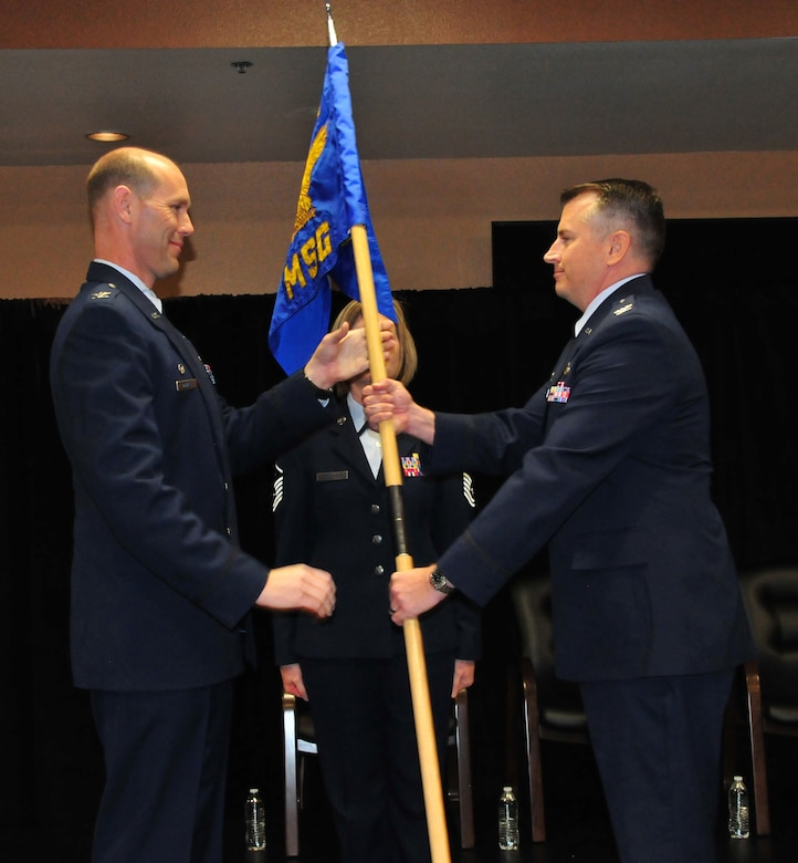 Col. David J. Ciesielski accepts the 161st Mission Support Group guidon from Col. Troy T. Daniels, commander 161st Air Refueling Wing during the 161st MSG change of command at Phoenix Sky Harbor Air National Guard Base, Dec. 6, 2015. Col. Ciesielski succeeds Col. Kyle T. Kobashigawa as commander of the 161st MSG. (U.S. Air National Guard photo by Master Sgt. Kelly Deitloff)