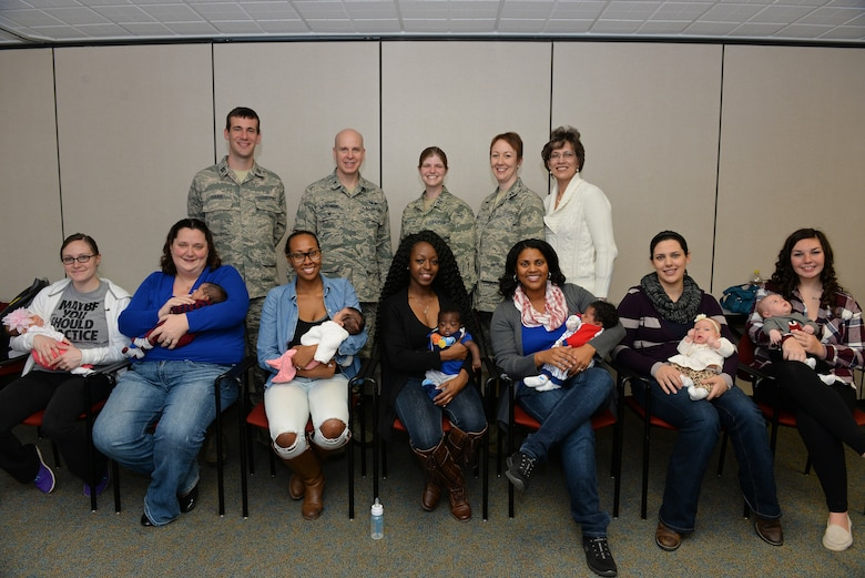 New moms who participated in a Centering Pregnancy support group gathered for a reunion along with family medicine physicians who either facilitated the group or delivered their babies, Dec. 1, 2015, Belleville, Illinois. The support group came together to celebrate the birth of their children and discuss how the group helped them prepare for labor and the first weeks of their children's lives. (U.S. Air Force photo by Airman 1st Class Erica Holbert-Siebert)