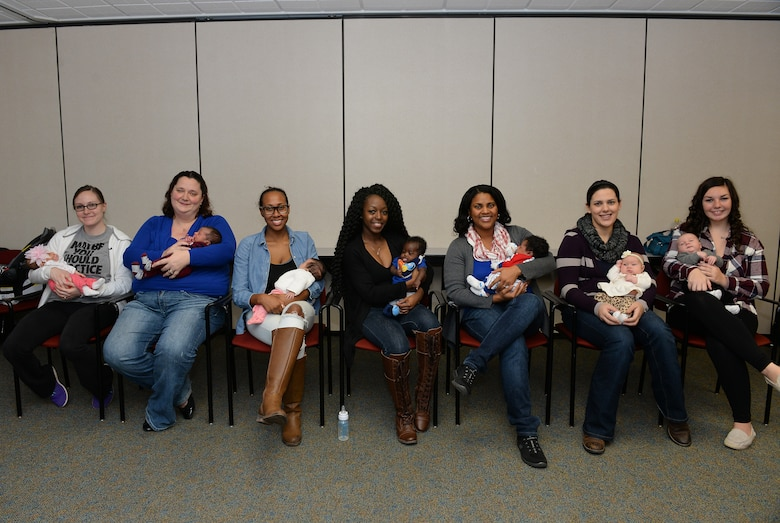 New moms who participated in a Centering Pregnancy support group gathered for a reunion, Dec. 1, 2015, Belleville, Illinois. The support group came together to celebrate the birth of their children and discuss how the group helped them prepare for labor and the first weeks of their children's lives. (U.S. Air Force photo by Airman 1st Class Erica Holbert-Siebert)