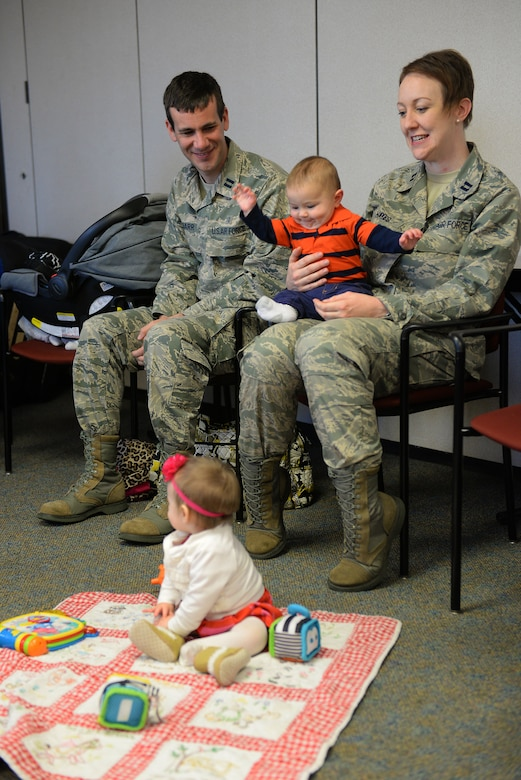 Family medicine physicians discuss raising young children during a Centering Pregnancy support group reunion, Dec. 1, 2015, Belleville, Illinois. The support group reunited to celebrate the birth of their children and discuss how the group helped them prepare for labor and the first weeks of their children's lives. (U.S. Air Force photo by Airman 1st Class Erica Holbert-Siebert)