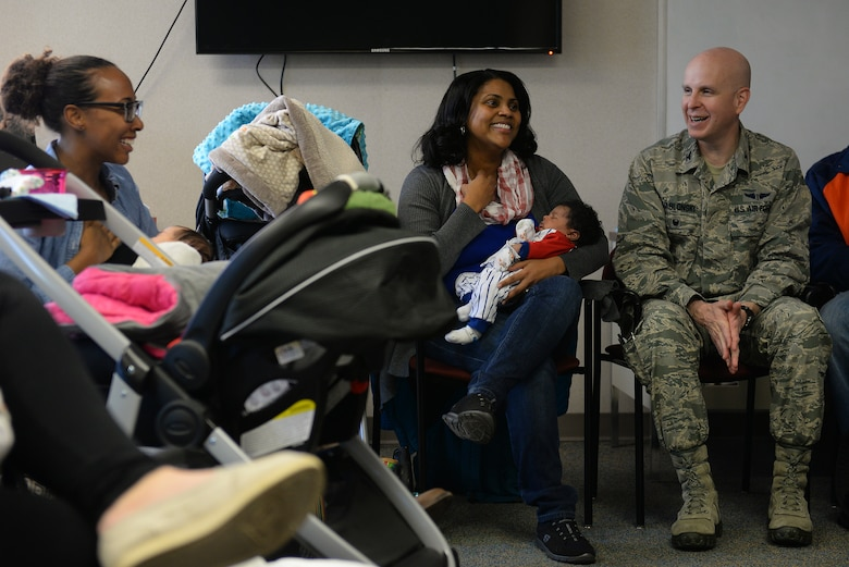 Col. James Jablonski, 375th Medical Group family residency program master academician, talks with new moms during a Centering Pregnancy support group reunion, Dec. 1, 2015, Belleville, Illinois. Jablonski is one of the family medicine physicians who facilitate the support group, another of which will be starting in January. (U.S. Air Force photo by Airman 1st Class Erica Holbert-Siebert)