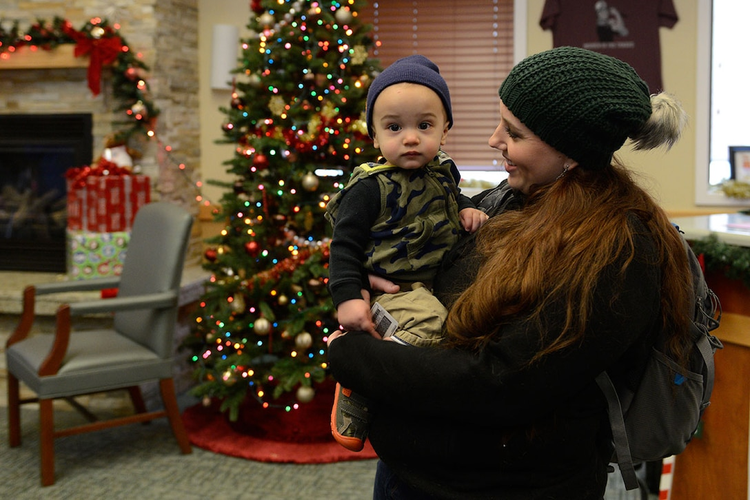 Sara Foster, laughs with son, Luke Foster,1, during Operation Warmheart's holiday toy drive, at Joint Base Elmendorf-Richardson, Dec. 4, 2015. The Operation Homefront holiday toy drive is a program used to distribute toys and gift cards to junior enlisted military families. Luke is the son of Tech. Sgt. Jeremy Foster, with the 732nd Air Mobility Squadron. (U.S. Air Force photo by Airman Valerie Monroy)