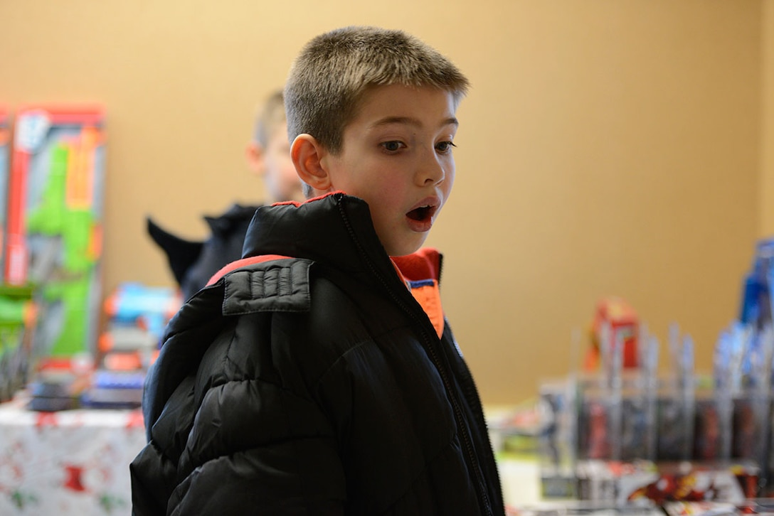 Ethan Niedermeyer, 11, shows his excitement at seeing all the toys at Operation Warmheart's holiday toy drive, at Joint Base Elmendorf-Richardson, Dec. 4, 2015.  In 2014, millions of toys were donated nationwide through Operation Homefront. Ethan is the son of Staff Sgt. Joshua Niedermeyer, with U.S. Army Alaska. (U.S. Air Force photo by Airman Valerie Monroy)