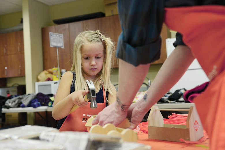 Ellie Hamblin, 6, builds a tool box during Operation Homefront's holiday toy drive. Holiday gifts were distributed to junior enlisted family members to show appreciation and enhance junior enlisted families holidays. Ellie is the daughter of Staff Sgt. Daniel Hamblin, with the 962nd Airborne Air Control Squadron, and Sara Hamblin. (U.S. Air Force photo/Airman Valerie Monroy)