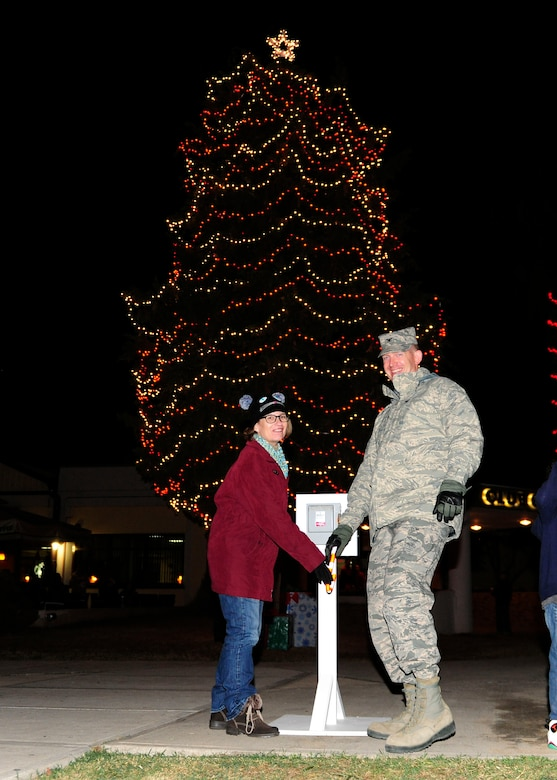 Col. John Walker, 39th Air Base Wing commander, and his wife Ms. Walker, flip the switch to light officially light the tree during the 2015 Incirlik Holiday Tree Lighting ceremony Dec. 1, 2015, at Incirlik Air Base, Turkey. Events of the tree lighting included a speech from Col. John Walker, 39th Air Base Wing commander, a visit from Santa Claus and the singing of holiday carols. (U.S. Air Force photos by Senior Airman Krystal Ardrey/Released)