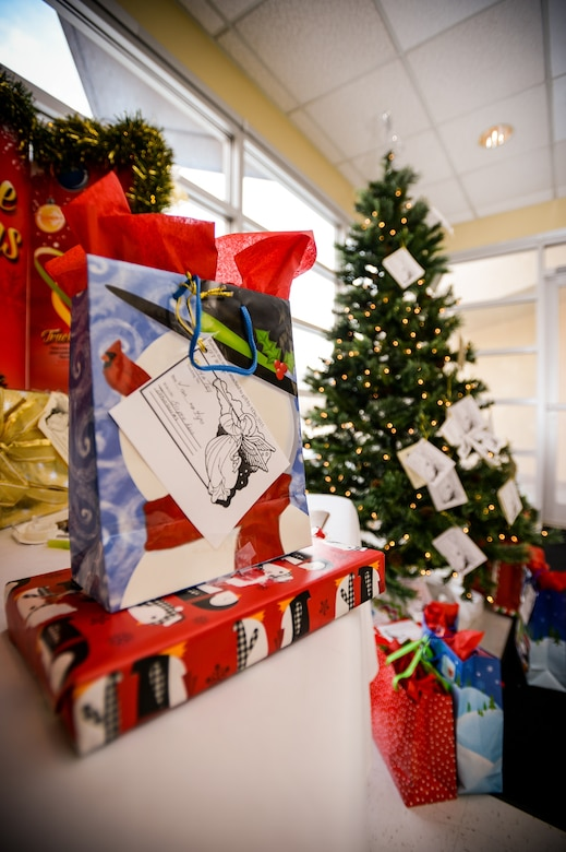 an angel tree gift sits atop a table in the foyer of the hill air force