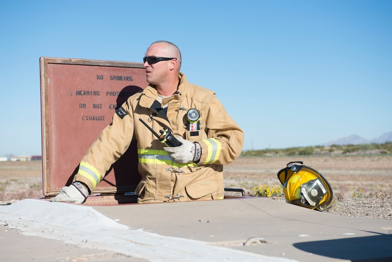 Staff Sgt. Michael Hussey with the 162nd Wing Fire Department responded to a mock aircraft emergency during a test performed Dec 5, 2015 at Tucson International Airport. The 162nd Wing performs certification exercises annually to ensure the equipment and personnel are ready to prevent a crash and save lives. (U.S. Air National Guard Photo by Staff Sgt. Gregory Ferreira/ Released)