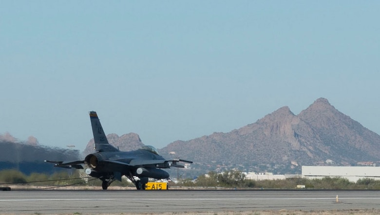 An Arizona Air National Guard F-16 Fighting Falcon catches the barrier cable during a test performed Dec 5, 2015 at the Tucson International Airport. The 162nd Wing performs certification exercises annually to ensure the equipment is ready to prevent a crash and save lives. (U.S. Air National Guard Photo by Staff Sgt. Gregory Ferreira/ Released)