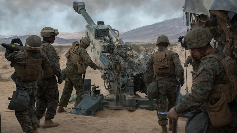 Marines with Battery I, 3rd Battalion, 11th Marine Regiment, 1st Marine Division, fire an M777 Howitzer¬ during the opening day of live-fire operations for Steel Knight at Marine Corps Air Ground Combat Center Twentynine Palms, Calif., on Dec. 10, 2015. The tough, realistic training is intended to develop combat skills necessary to operate as the ground combat element of the I Marine Expeditionary Force.