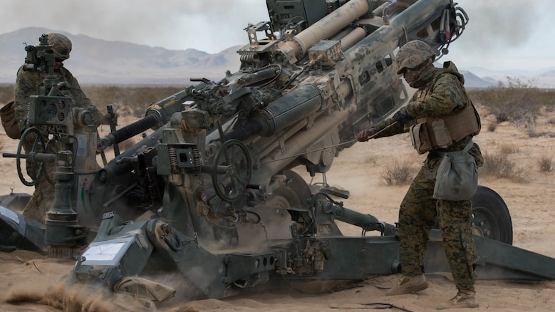 Marines with Battery I, 3rd Battalion, 11th Marine Regiment, 1st Marine Division, fire an M777 Howitzer¬ during the opening day of live-fire operations for Steel Knight at Marine Corps Air Ground Combat Center Twentynine Palms, California, on Dec. 10, 2015. The tough, realistic training is intended to develop combat skills necessary to operate as the ground combat element of the I Marine Expeditionary Force.